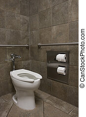 clean white toilet in a public restroom with dark stone...