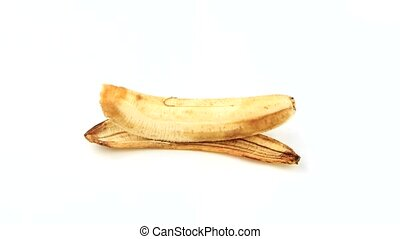 Banana dark Time Lapse - Banana on a white background Lies...