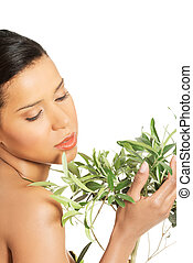 Woman with health skin and with olive tree