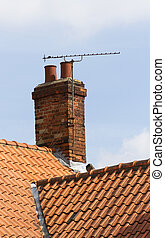 Tv aerial on old chimney - television aerial attached to an...
