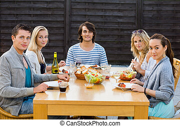 Friends Enjoying Meal At Outdoor Party