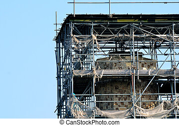 Scaffoling with old building