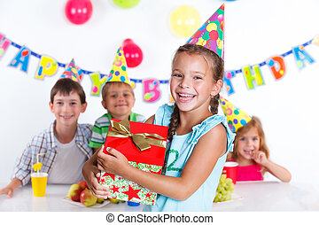 Girl with giftbox at birthday party - Beautiful girl with...