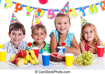 Kids with birthday cake - Group of adorable kids having fun...