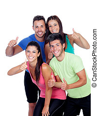 Group of friends with fitness clothes saying Ok isolated on...