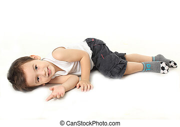A little boy lie down on the floor