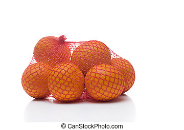 Bunched of oranges in netting isolated on white - A bunch of...