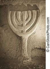ancient stone Menorah - a jewish Menorah rock carved at the...