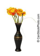 vase of orange flowers on a white background
