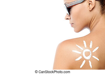 Young woman with sun tan lotion - Rear view image of woman...