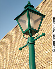 Lamp Post on brick - Top of a green lamp post, with a brick...