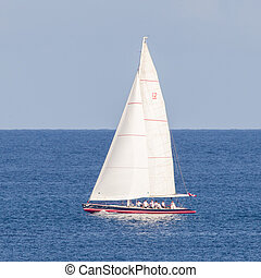 Small sailboat sailing on sea