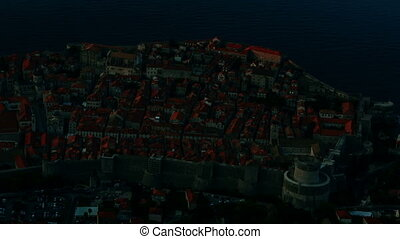 Sunrise over old stone city walls of Dubrovnik