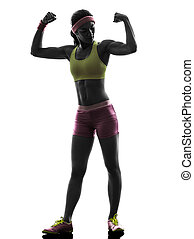 woman exercising fitness flexing muscles  silhouette