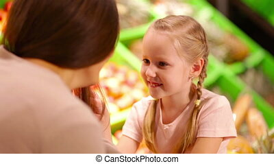 Motherly tenderness - Close-up of a tender mom talking to...