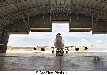 plane boeing 747 in the hangar an airport