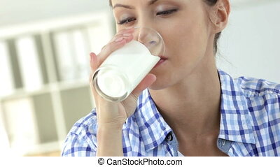 Milk moustache - Lovely girl drinking fresh milk and getting...