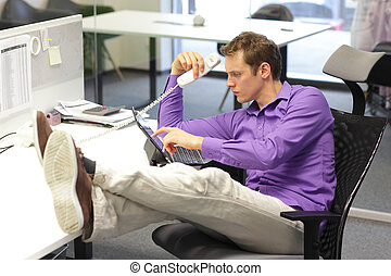 bad sitting posture in office - Young businessman caucasian...