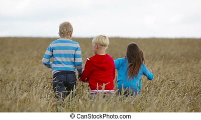 Kids in the fields - Kids running far away out in the fields