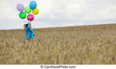 Carefree childhood - Charming girl holding a bunch of...