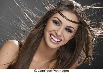 Smiling girl with blowing hair - Portrait of beautiful happy...