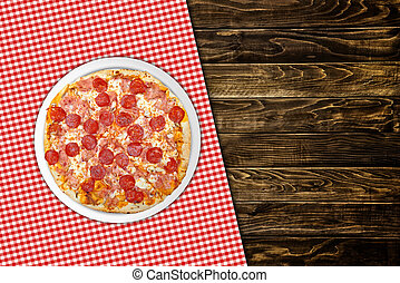 Pepperoni pizza on wood table