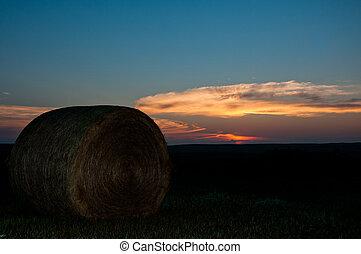 Sunrise in ND - Bale of hay in fields of ND