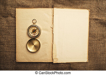 Old open book with compass