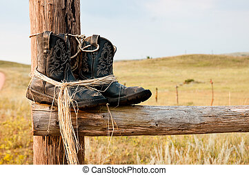 Long Days Over - Retired Black Cowboy boots sitting on Fence