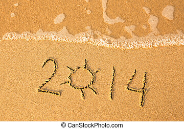 2014 written in sand on beach texture, soft wave of the sea