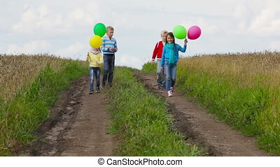 Let go of summer - Cheerful kids letting go of balloons...
