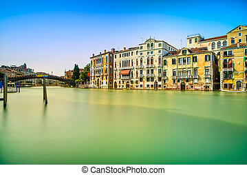 Venice cityscape, water grand canal, accademia bridge and traditional buildings. Italy.