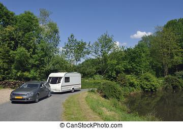 Caravan passing a lake - Caravan passing a small lake at a...