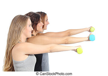 Group of fitness women with dumbbells