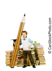 heap of books - A boy standing near the pile of books and...