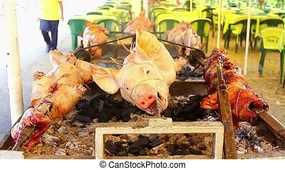 Meat on the spit - Animals over fire pit being automatic...