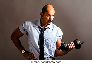 business training - strong business man is raising a...