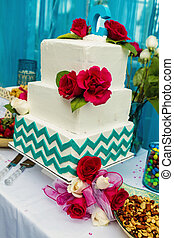 Wedding cake with floral decorations teal and ivory