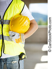 Construction workers - Construction worker is working on new...