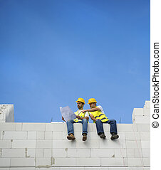 House construction - Construction Contractors building a big...