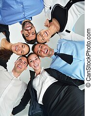business people with their heads together - Closeup of happy...