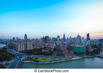 cityscape of shanghai bund at dusk - aerial view of shanghai...