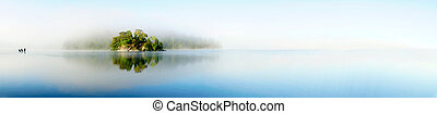 island on foggy morning - Panoramic view of island in lake...