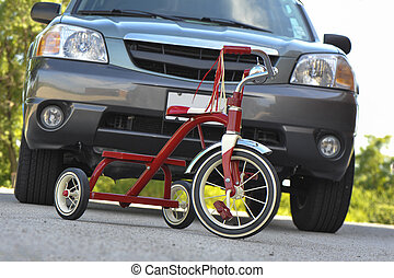 Child's Tricycle in front of SUV
