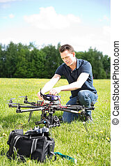 Engineer Fixing UAV Drone - Young engineer fixing UAV drone...