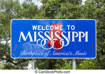 Red, white, and blue sign to welcome travelers to...
