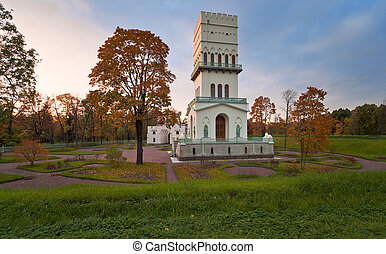 White tower in autumn Aleksandrovsky park of Pushkin next to...