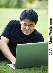 Asian college student - An asian college student working on...