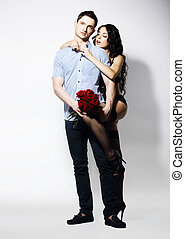Allurement. Affectionate Romantic Couple with Bouquet of Flowers