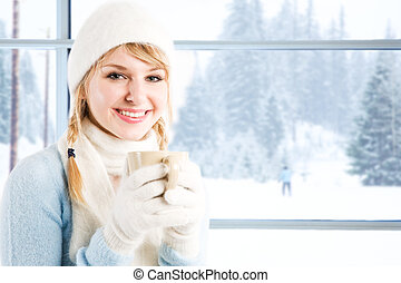 Caucasian girl drinking coffee - A beautiful caucasian girl...